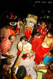 lion dance troupe leader receiving blessings