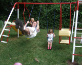 daddy swinging with the kids