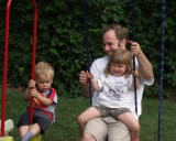 daddy swinging with the kids - 2