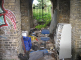 Gated, locked area under Surrey side of bridge.