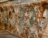 Carved marble frieze behind the alter.