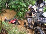 Trying to get a Fourtrax out of the river...