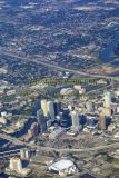 Aerial of downtown Tampa, Florida - Raymond James Stadium & Legends Field faint on the top middle of image