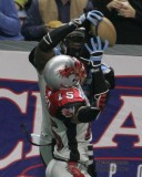 Kansas City Brigade WR Boo Williams grabs a touchdown over Grand Rapids Rampage DB Chuck Wesley