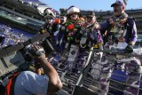 Baltimore Ravens fans with CBS cameraman Larry Frazier