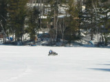 Snowmobile on Hills Pond