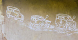 Kenya -- kids chalk drawing of big SUV vehicles (government, aid projects) that pass by the village (1986-87)