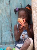 Mozambique -- playing with her doll