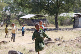 Children run to investigate us as we hike by their school