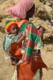 A tigray woman and her child near the Tombs of Kaleb and Gebre Meskel