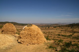 Piles of hay, with a scenic vista looking northward toward Eritrea, near the tombs of Kaleb and Gebre Meskel.