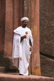 A priest at the entrance to Bet Giorgis