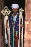 Another priest shows us the traditional crosses under his care