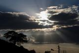 The sun streams through clouds over Lalibela