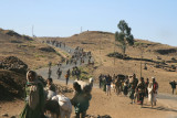 A road near Lalibela being traversed by people carrying items to market