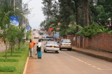 Streets of Kigali.  Note the street cleaners -- the streets are extremely clean and well-maintained.