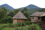 Mt. Gahinga Lodge with two of the Virunga Volcanoes in the background: Muhabura and Gahinga.
