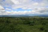 A panoramic view northward from the observation platform, a few minutes' hike from the visitor center.  From here, you can see the town of Bunagana, Lake Mutanda and, in the distance, the Bwindi Impenetrable Forest.