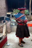 An Andean woman shows off her handicrafts