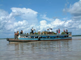 Riverboat loaded with people and cargo