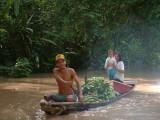 A family, their canoe and bananas