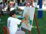An artist paints a model in Iquitos
