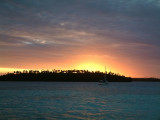 The sun sets behind Ovalu Island and sets the stage for a fantastic light show