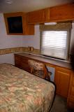 04- Master Bedroom with right rear slider open (desk / vanity)
