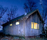 Hill top cabin at night