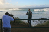 Weather Channel reporter/camera man doing story on high winds and surf