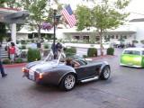 Shelby Cobra underneath Old Glory at Portola Plaza