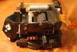 Left side. Lens mount side facing down