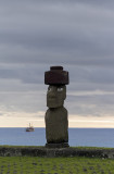 Moai in Hanga Roa, with freighter from Chilean mainland in background.