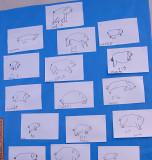 Alex drew the top pig.