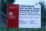Sign in front to Repaired Wall