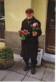 An old man selling flowers