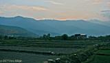 Farmland set against Mountains
