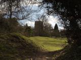 Clavering church across the castle earthworks