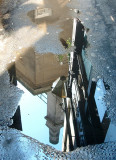 Puddle reflections in Gate Street,WC2