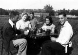 My father at the left of the photo in Sioux City, Iowa playing cards with his cousins. Taken around 1939.