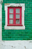 The red window and the green wall