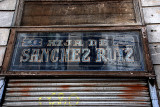 Aged shop signs from abroad: stories told in other languages, too
