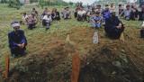 Burying strangers