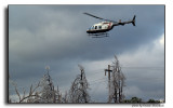Downed GRDA 69KV Transmisson line inspected by a GRDA Helicopter