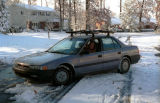 Teacher setting out for long drive to school.