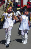 Two Small Dolls Are Leading Parade, Puno