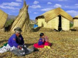 Grandma Grinds The Grains, Uros Island, Titicaca Lake