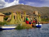 Family Picnic On Islands Of Uros, Lake Titicaca