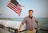 Here I am on the Mystic Blue cruise ship in front of the American flag.