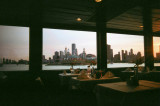 This is the dining area on the Mystic Blue with a skyline view through the windows.